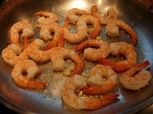 scampi is sauteeing in garlic butter